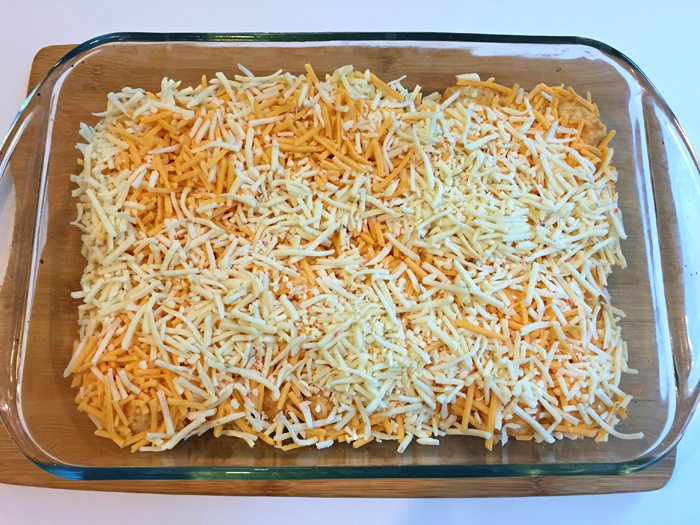 Spread shredded cheese over tater tots for Christmas morning casserole