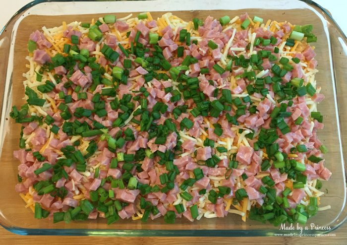 Sprinkle ham and green onions over shredded cheese and tater tots