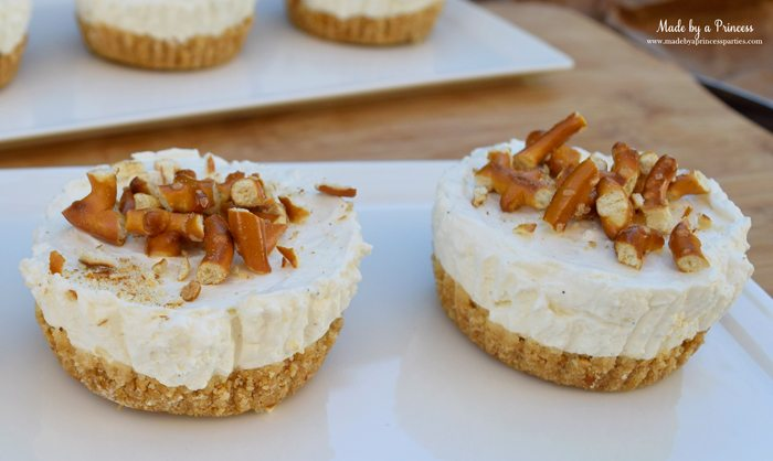 easy creamy pretzel crust no bake cheesecake crushed pretzels on top