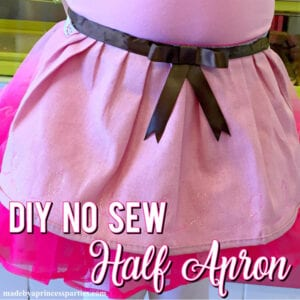 Need a cute apron for Halloween or dress up? Learn how to make this easy no sew half apron in less than 30 minutes