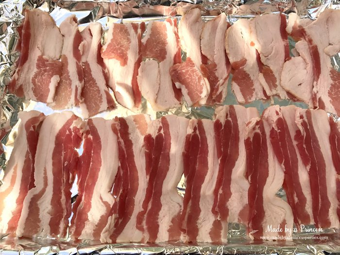 Man Candy Sweet Spicy Candied Bacon Recipe place bacon in a foil lined cookie sheet