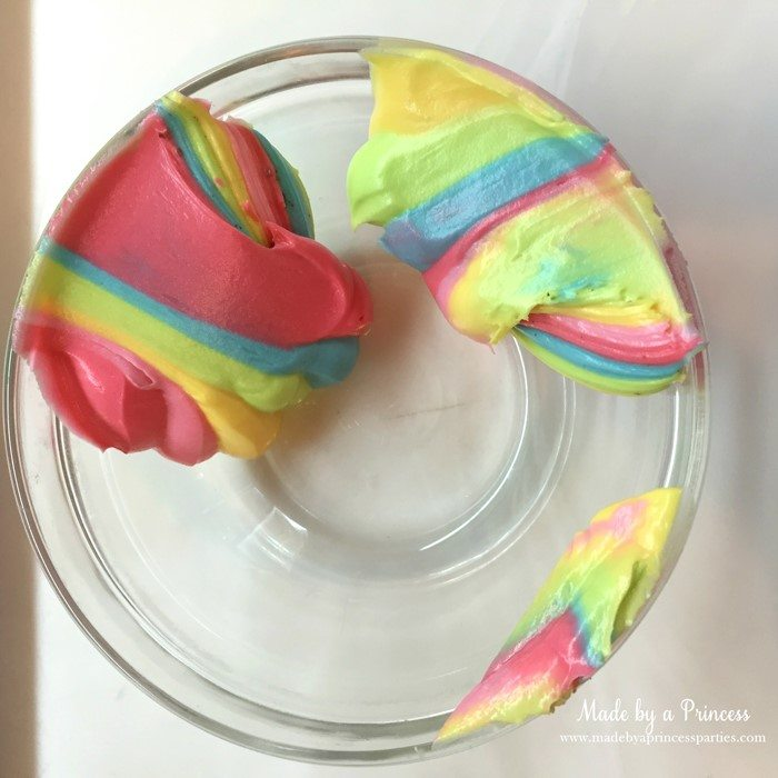 Unicorn Party Rainbow Brownies Recipe scrape frosting into a bowl and use to decorate cupcakes