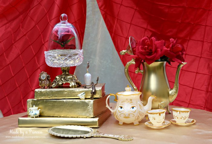Host a quaint BEAUTY AND THE BEAST Themed Tea Party for Two. Paint a stack of books and thrift store find teapot gold to create a beautiful centerpiece.