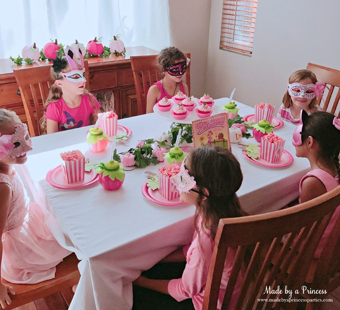 Pink Pumpkin Halloween Party Ideas girls chatting over pink popcorn Made by a Princess #pinkparty #pinkoween #pinkpumpkinparty