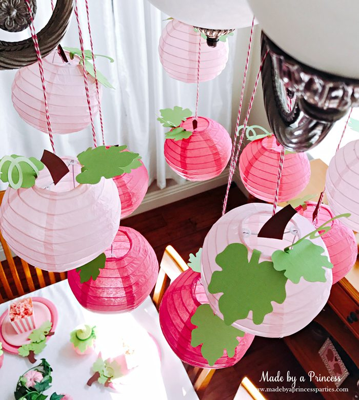 Pink Pumpkin Halloween Party Ideas pink pumpkin paper lantern chandelier Made by a Princess #pinkparty #pinkoween #pinkpumpkinparty