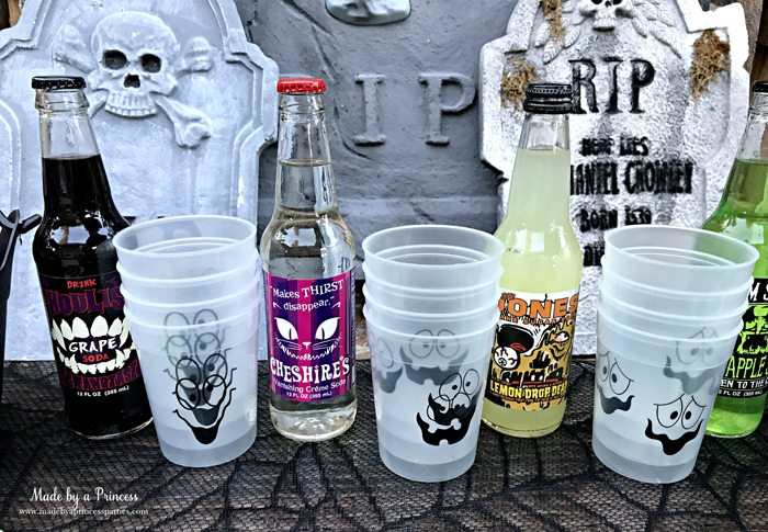 Teen Halloween Party Ideas glow in the dark cups halloween themed drinks Made by a Princess #halloweenparty #teenhalloween