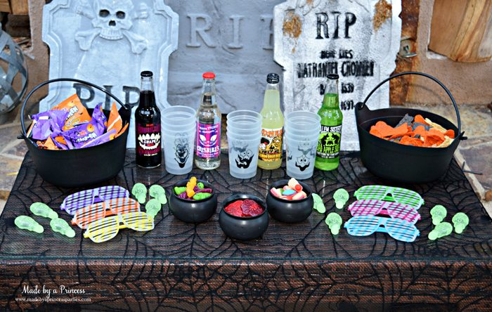 Teen Halloween Party Ideas simple table of snacks drinks and treats Made by a Princess #halloweenparty #teenhalloween