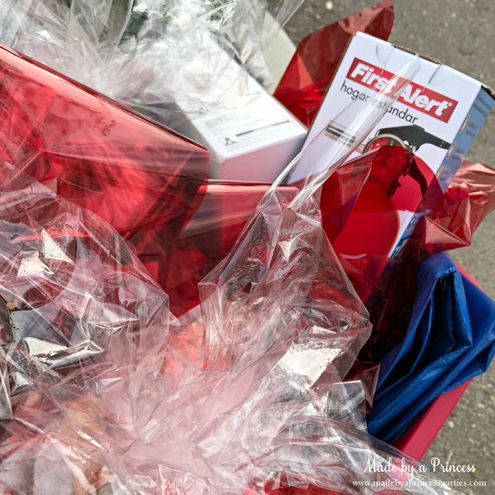 Unique School Silent Auction Idea Emergency Preparedness Kit items wrapped in cellophane and placed in bucket