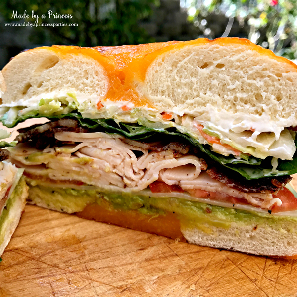 Best Turkey BLT Sandwich Recipe filled with avocado. swiss cheese. cole slaw. and candied bacon via @madebyaprincess #turkeysandwich #blt #bltsandwich #bestsandwich #recipe #turkeyblt