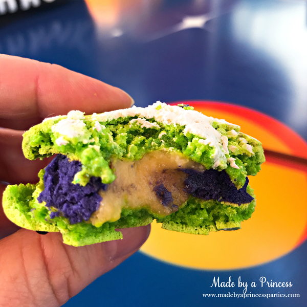 Disneylands Best Pixar Fest Food Checklist Toy Story Alien Macaron inside filled with lemon blackberry #disneylandfood #disneyfood #toystory #pixarfest #madebyaprincess