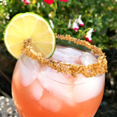 Copycat Disney Rose Gold Margarita garnish with gold sprinkles #disneycocktail #rosegoldmargarita #copycatdisneyrecipe @madebyaprincess