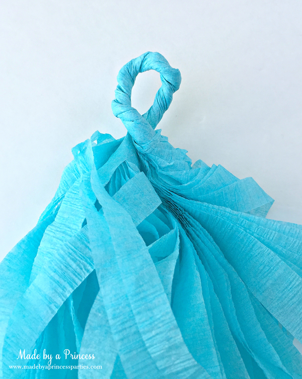 How to Make Tassel Garland with Crepe Paper twist at the top and run twine through loop to hang