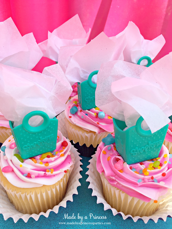 Shopkins Birthday Party Ideas use Shopkins shopping bags as cupcake toppers