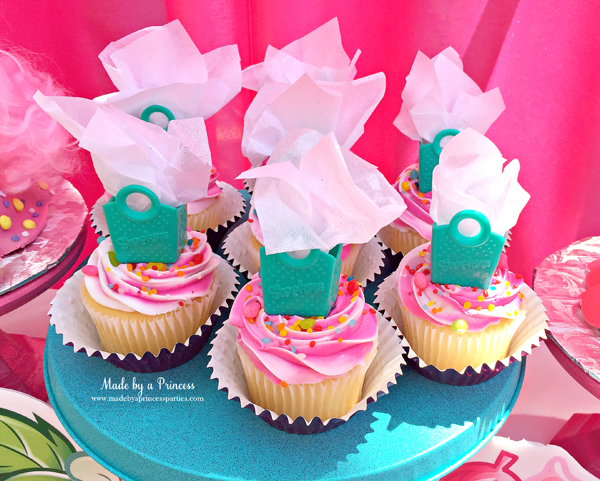 Shopkins Birthday Party Ideas use Shopkins shopping bags with tissue paper as cupcake toppers