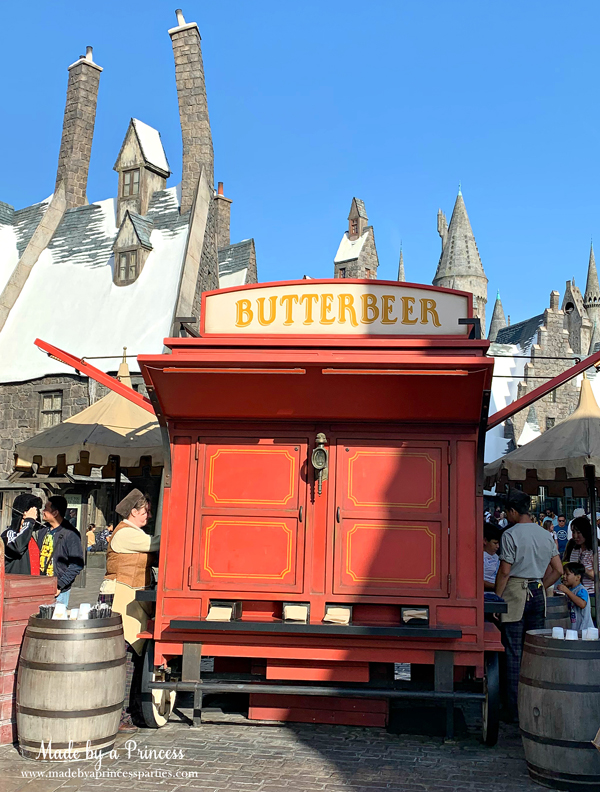 Buy Butterbeer at the Butterbeer cart in Hogsmeade
