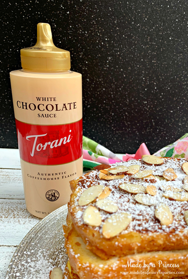 Garnish marzipan stuffed french toast with Torani White Chocolate Sauce