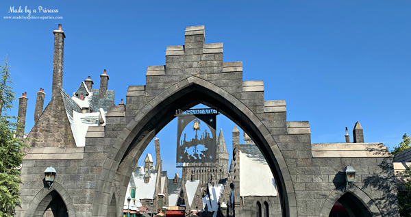 Gates of Hogsmeade says Please Respect the Smell Limits
