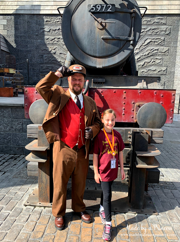 Greeted by the conductor in Hogsmeade in Wizarding World of Harry Potter