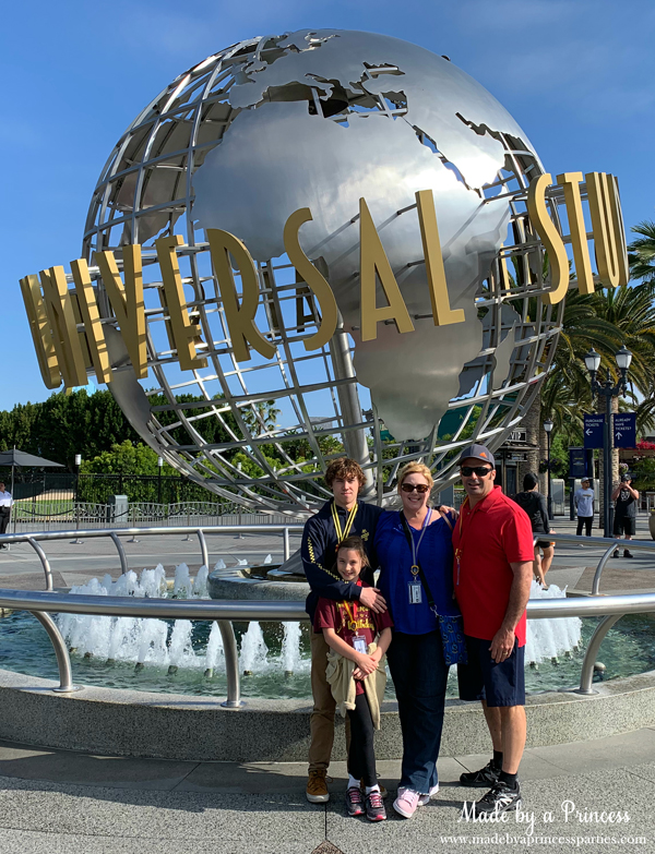 Picture of the family in front of the Universal Studios globe