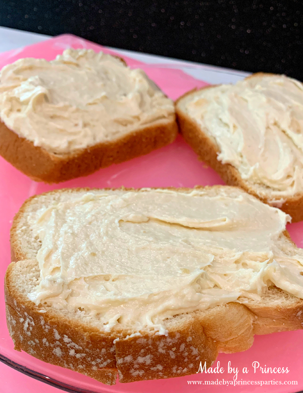 Spread marzipan cream cheese filling on fresh bread for this marzipan stuffed french toast recipe