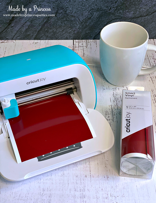 Cut off a piece of Cricut Joy Smart Vinyl and load it into the machine with no mat