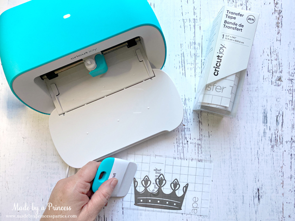 use the Cricut Joy scraper to smooth out small decals